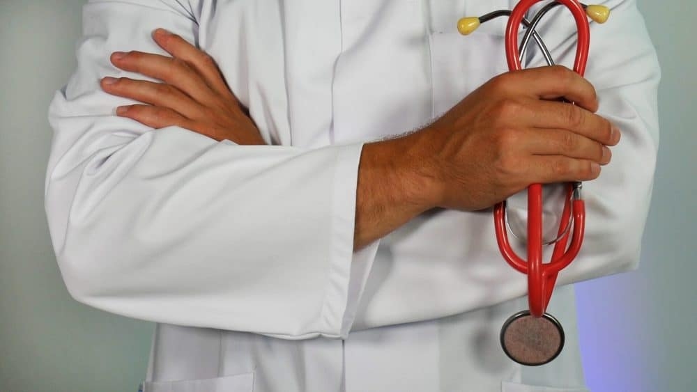 doctor with crossed arms holding stethoscope