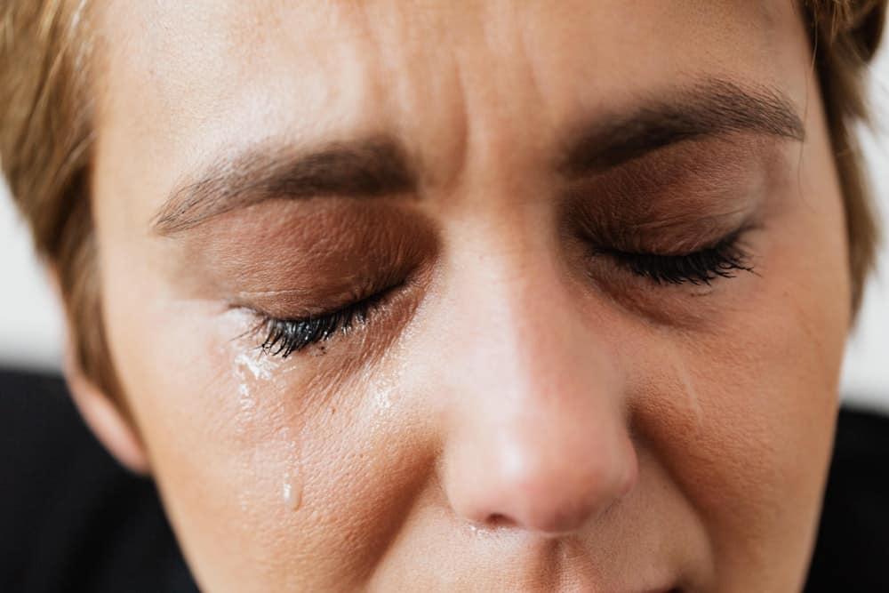close up woman weeping